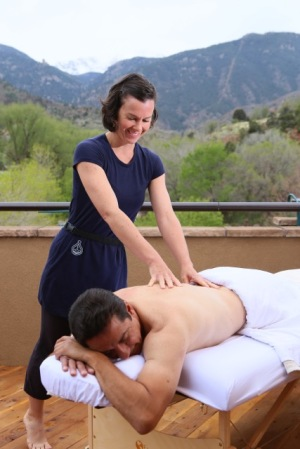 Enjoying an outdoor massage with the view of Pikes Peak